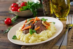 Fried chicken liver with vegetables and garnish of mashed potatoes. Healthy food Royalty Free Stock Photos