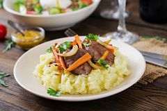 Fried chicken liver with vegetables and garnish of mashed potatoes. Healthy food Stock Photography