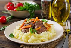 Fried chicken liver with vegetables and garnish of mashed potatoes. Healthy food Royalty Free Stock Images