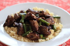 Fried chicken livers with couscous and green beans. Royalty Free Stock Photography