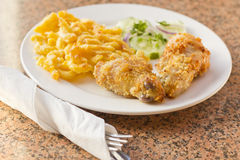 Fried Chicken Mac N Cheese. Country fried chicken with home made macaroni and cheese with cucumbers Stock Image