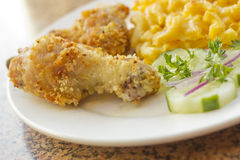 Fried Chicken Mac N Cheese. Country fried chicken with home made macaroni and cheese with cucumbers Stock Photo