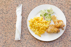 Fried Chicken Mac N Cheese. Country fried chicken with home made macaroni and cheese with cucumbers Stock Photos