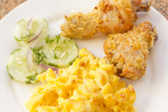 Fried Chicken Mac N Cheese. Country fried chicken with home made macaroni and cheese with cucumbers Royalty Free Stock Photo