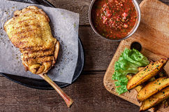 Fried chicken meat on the bone, potato wedges Stock Images