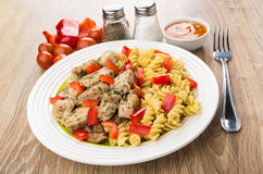 Fried chicken meat with pasta and pepper, spices, sauce, fork Royalty Free Stock Photos