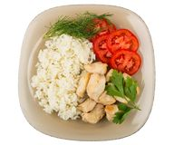 Fried chicken meat with rice and tomatoes in brown plate Stock Photography