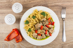 Fried chicken meat with spiral pasta and sweet pepper Royalty Free Stock Image