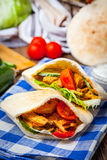 Fried chicken meat with vegetables in pita bread Royalty Free Stock Photos