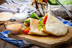 Fried chicken meat with vegetables in pita bread Royalty Free Stock Photography