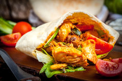 Fried chicken meat with vegetables in pita bread Royalty Free Stock Photo