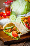 Fried chicken meat with vegetables in pita bread Stock Photography