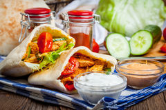 Fried chicken meat with vegetables in pita bread Stock Photo