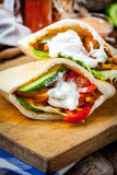 Fried chicken meat with vegetables in pita bread Royalty Free Stock Images