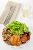 Fried chicken with mushrooms, salad Royalty Free Stock Photography