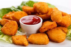 Fried chicken nuggets Stock Photos