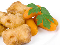 Fried chicken nuggets with baby carrots Stock Image