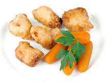 Fried chicken nuggets with baby carrots Royalty Free Stock Image