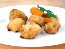 Fried chicken nuggets with baby carrots Royalty Free Stock Photos