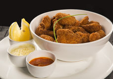 Fried chicken nuggets and lemon and peppers sauce Stock Photo