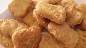 Fried Chicken Nuggets. Macro image of fried chicken nuggets Stock Image