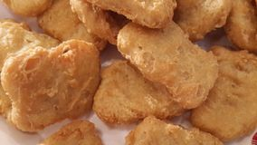 Fried Chicken Nuggets. Macro image of fried chicken nuggets Royalty Free Stock Images