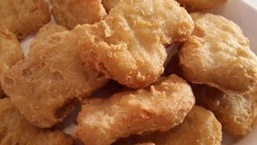 Fried Chicken Nuggets. Macro image of fried chicken nuggets Royalty Free Stock Photography