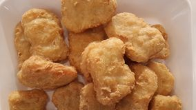 Fried Chicken Nuggets. Macro image of fried chicken nuggets Stock Photo