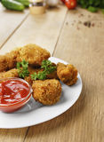 Fried chicken nuggets on the plate on the wooden table Stock Photography