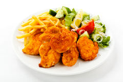 Fried chicken nuggets and vegetables Royalty Free Stock Photos