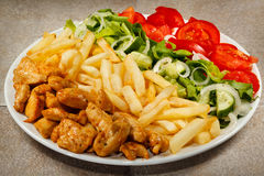 Fried chicken nuggets and vegetables royalty free stock photo