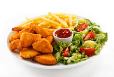 Fried chicken nuggets and vegetables Royalty Free Stock Image