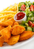 Fried chicken nuggets and vegetables Stock Photography