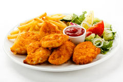 Fried chicken nuggets and vegetables Stock Photo
