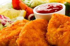 Fried chicken nuggets and vegetables Stock Images