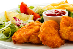 Fried chicken nuggets and vegetables Stock Photos