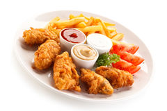 Fried chicken nuggets and vegetables Stock Image