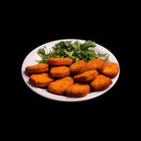 Fried chicken nugs. On black background still life Stock Photos