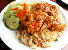 Fried Chicken Over Fried Rice. With sweet and sour sauce Stock Images