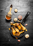 Fried chicken in pan with mushrooms , garlic and tomato sauce. Royalty Free Stock Image