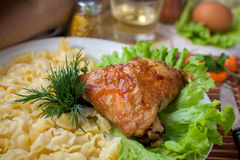 Fried chicken with pasta Stock Photography