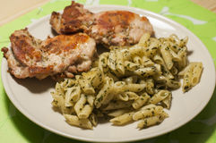 Fried chicken with pasta Stock Images