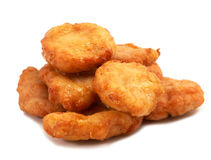Fried chicken pieces. Studio shooting of a fried chicken pieces (mcnuggets) on white background Stock Photography