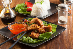 Fried chicken pieces in batter Stock Photography