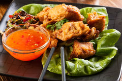 Fried chicken pieces in batter Royalty Free Stock Photo