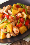 Fried chicken with pineapple in sweet and sour sauce close-up. V Stock Photo