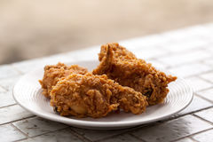 Fried chicken on a plate Royalty Free Stock Image