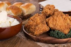 Fried Chicken Dinner. Fried chicken on a platter with mashed potatoes and rolls stock images