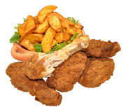 Fried Chicken Portions And Potato Wedges Royalty Free Stock Photos