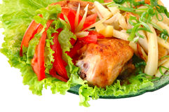 Fried chicken and potato. With vegetables (tomato and lettuce Royalty Free Stock Photo